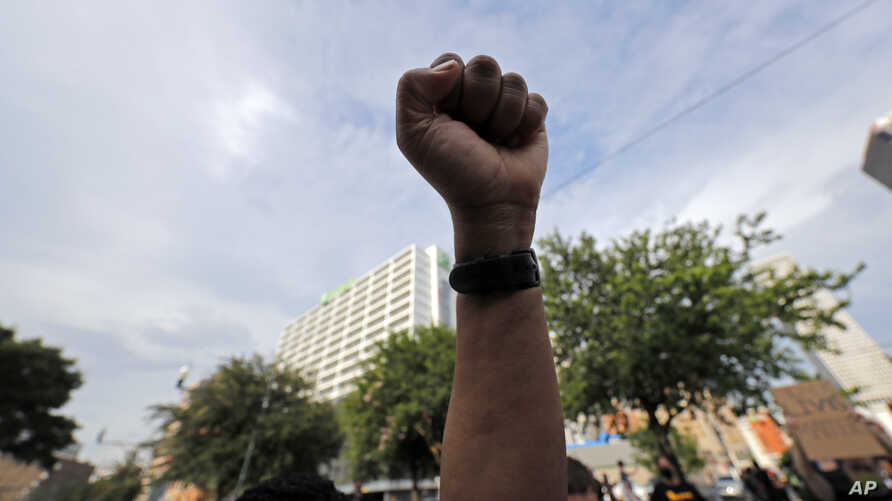 A demonstrator raises a fist in the air during a peaceful march in downtown New Orleans, Tuesday, June 2, 2020. They were…