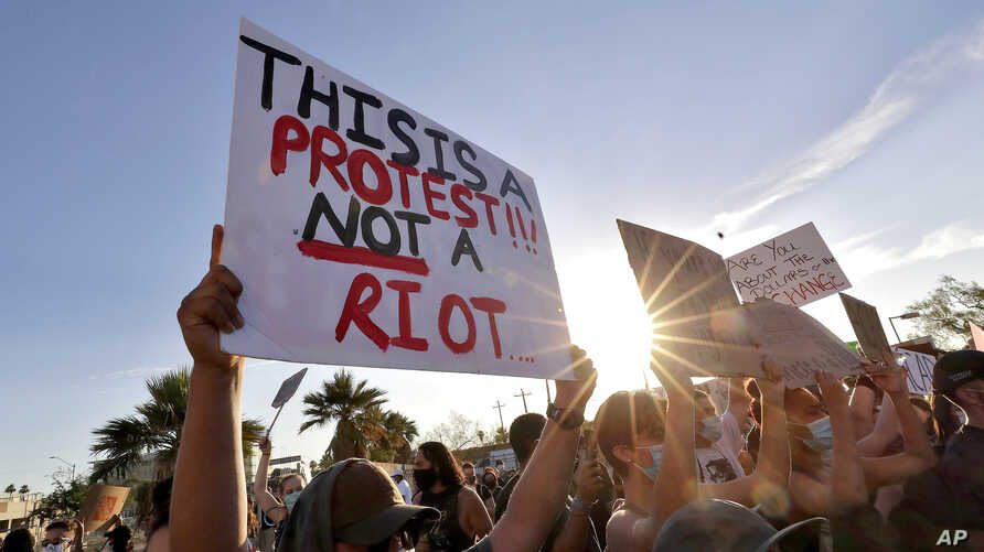 Protesters rally Tuesday, June 2, 2020, in Phoenix during demonstrations over the death of George Floyd