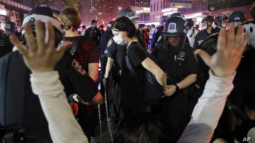 Police arrest protesters as they march through the streets of Manhattan, New York, June 3, 2020.