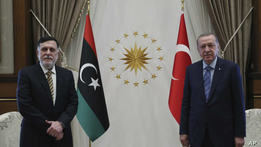 Turkey's President Recep Tayyip Erdogan, right, and Fayez Sarraj, the head of Libya's internationally-recognized government, speak prior to their talks in Ankara, Turkey, June 4, 2020.