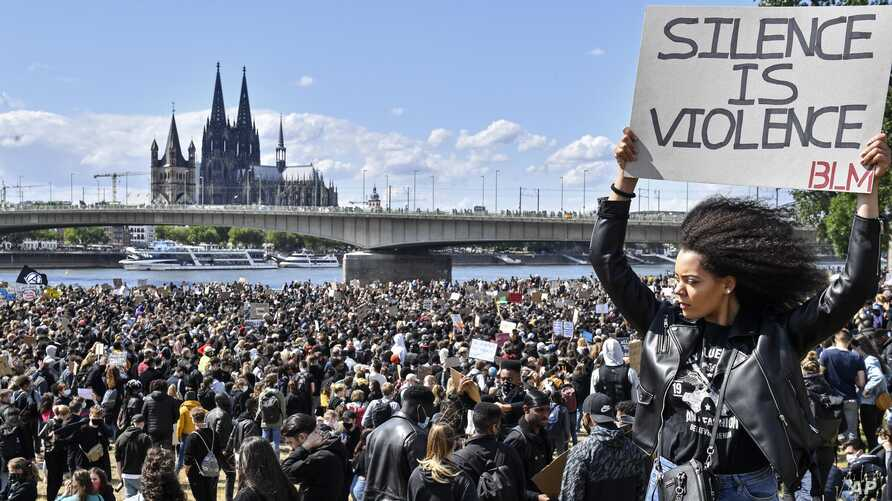 Thousands of people demonstrate in Cologne, Germany, June 6, 2020, to protest against racism