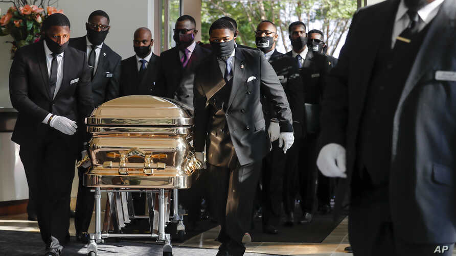Pallbearers bring the coffin into The Fountain of Praise church in Houston for the funeral for George Floyd on June 9