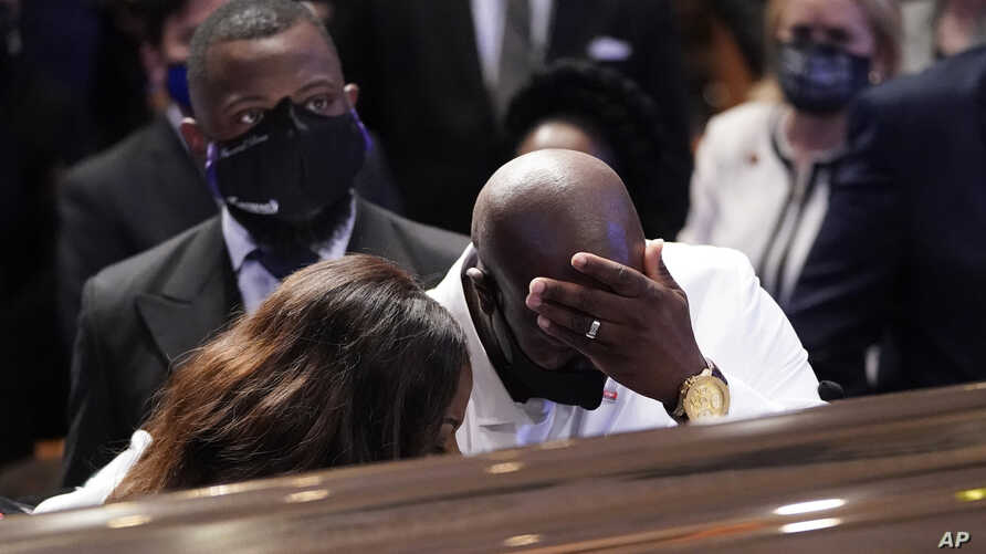 Philonise Floyd, brother, of George Floyd pauses at the casket during a funeral service for Floyd
