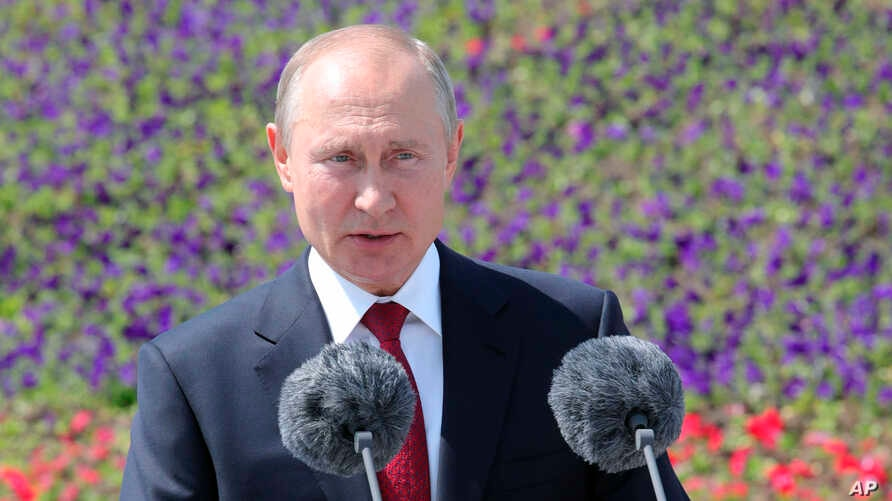 Russian President Vladimir Putin speaks during a ceremony of handing Gold Stars medals to heroes of labor marking the Day of Russia holiday in Moscow, Russia, June 12, 2020.