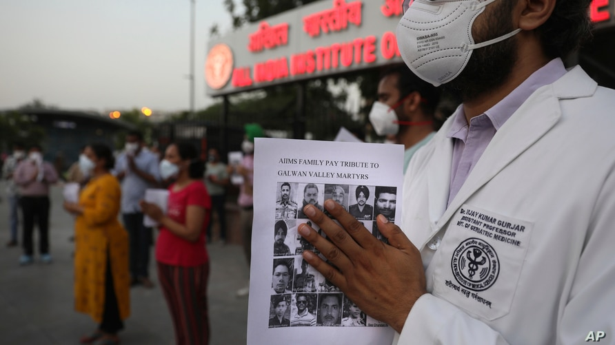 Doctors pay tributes to Indian soldiers killed during confrontation with Chinese soldiers in the Ladakh region, while holding…