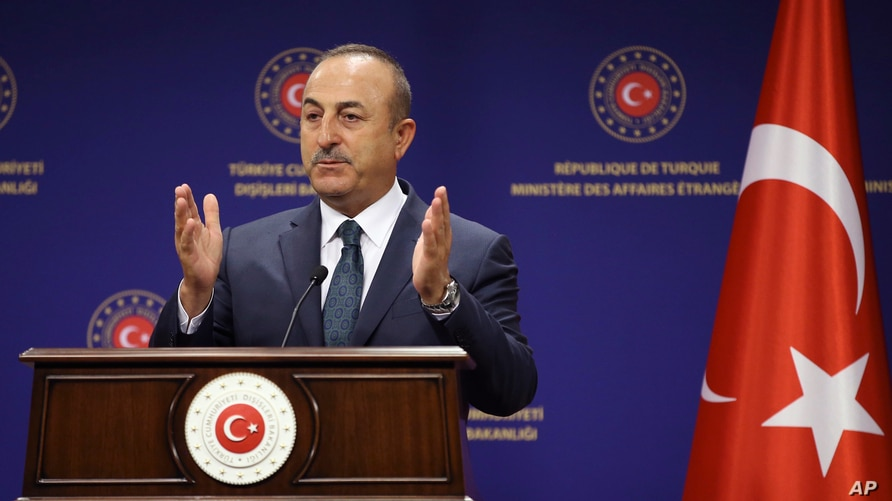 Turkey's Foreign Minister Mevlut Cavusoglu speaks during a joint press conference with Italy's Foreign Minister Luigi Di Maio, in Ankara, Turkey, June 19, 2020. Turkey and Italy continue to work for a lasting peace and political solution in Libya.