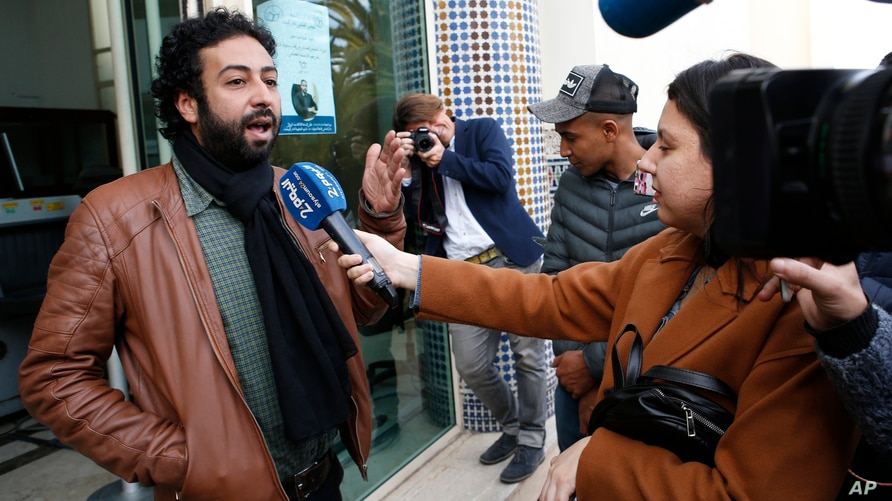 FILE - Moroccan journalist and activist Omar Radi speaks to the media after his hearing at the Casablanca Courthouse, In Casablanca, Morocco, March 5, 2020.