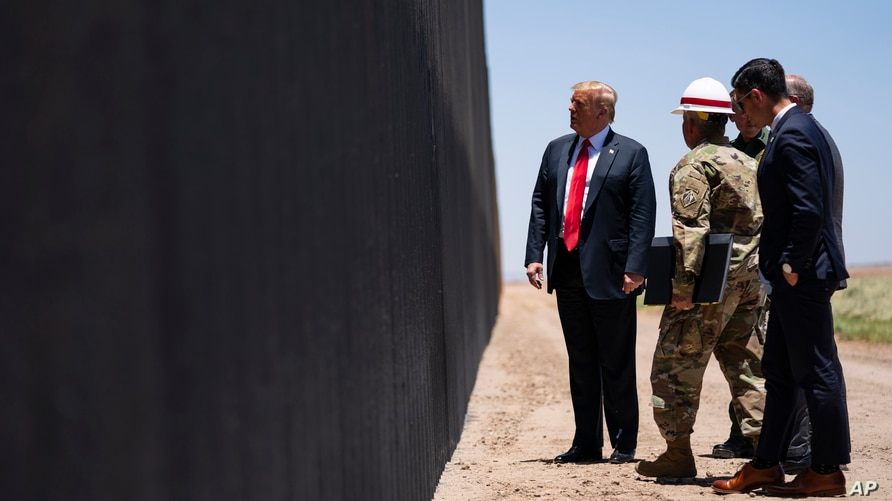 United State Border Patrol chief Rodney Scott gives President Donald Trump a tour of a section of the border wall, Tuesday,…