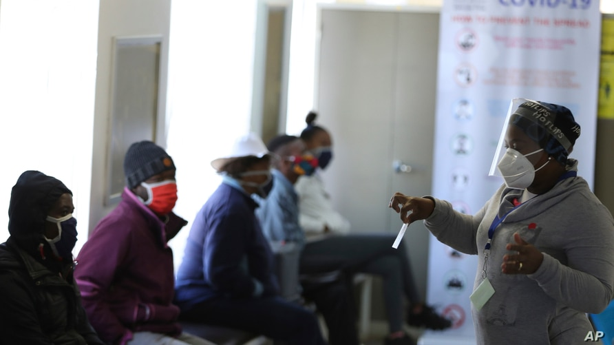 A medical worker addresses some of the first vaccine volunteers, at the Chris Hani Baragwanath hospital in Soweto, Johannesburg, June 24, 2020.