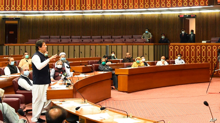 "In this photo released by the Press Information Department, Pakistani Prime Minister addresses the Parliament in Islamabad, Pakistan, June 25, 2020. Khan accused the United States on Thursday of having ""martyred"" al-Qaida leader Osama bin Laden."