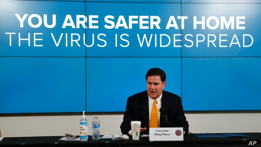 Arizona Republican Gov. Doug Ducey speaks about the latest coronavirus data at a news conference June 25, 2020.