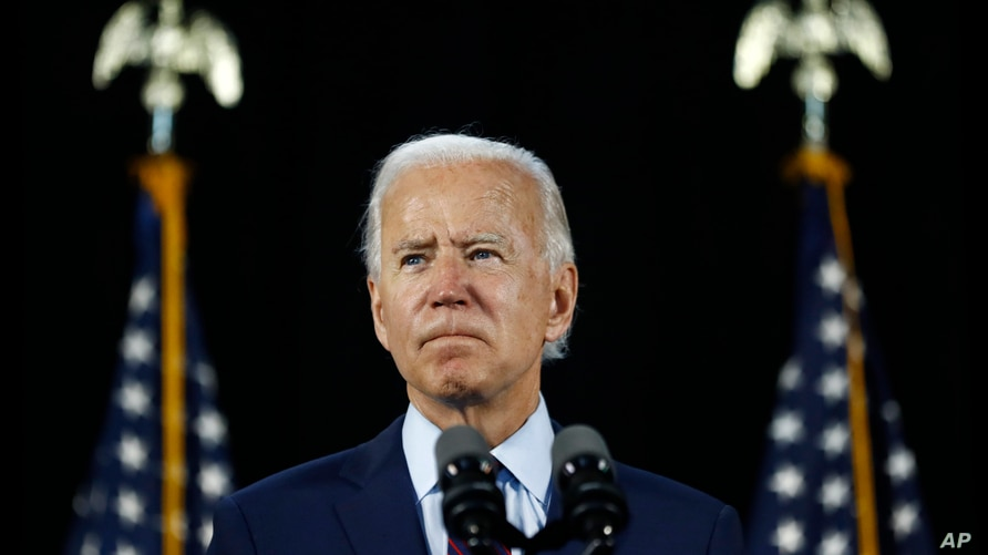 FILE - In this June 25, 2020, file photo Democratic presidential candidate, former Vice President Joe Biden pauses while…