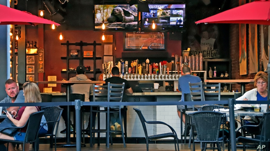 People gather at the North Shore Tavern in Pittsburgh on June 28, 2020.