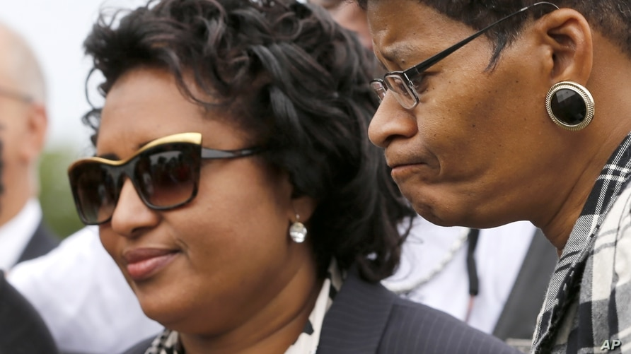 Kadiatou Diallo, mother of Amadou Diallo, left, and Geneva Reed-Veal, mother of Sandra Bland, listen to speakers during a…