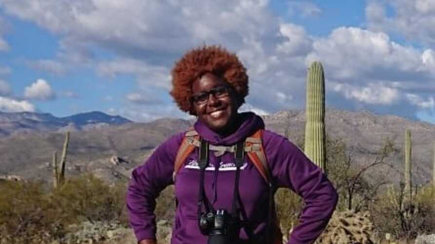 University of Arizona conservation biology graduate student Earyn McGee visits Saguaro National Park, Arizona. (Photo courtesy of Earyn McGee/Katherine Kennedy)