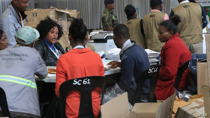 Electoral Commision officials at a tally centre in Blantyre verifying votes from districts