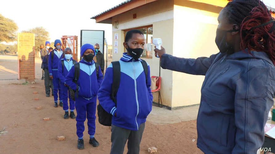 Students in Gaborone are checked for temperature before lessons start as part of new health regulations. (Photo: Mqondisi Dube)