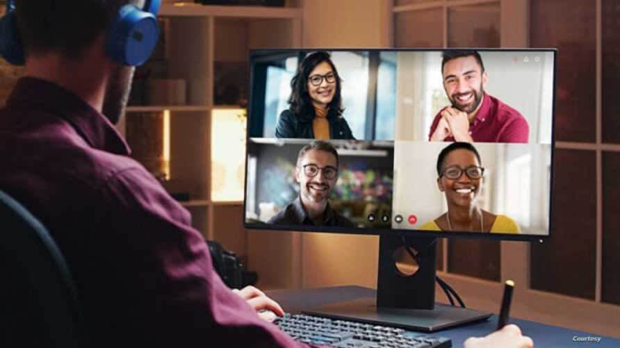A user watches a video conference in this promotional image from Gumzo