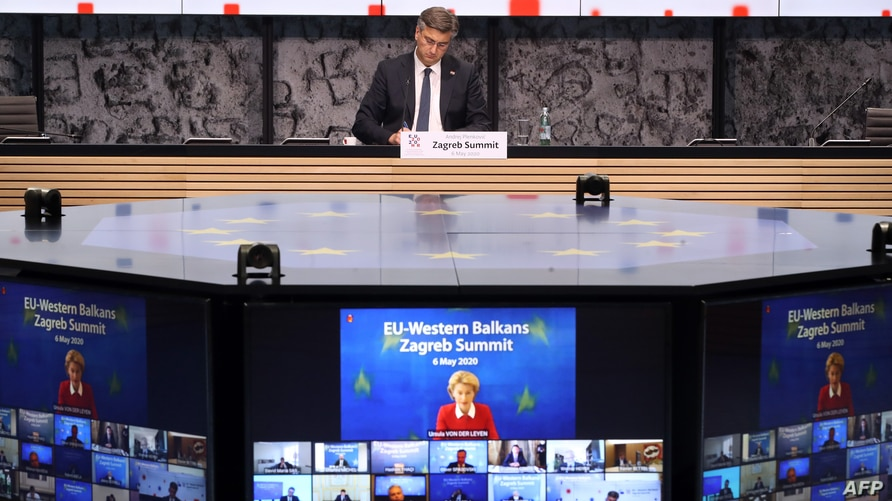 Croatian Prime Minister Andrej Plenkovic (C) takes part in a video conference with president of the European commission Ursula Von der Leyen (screen) and heads of state of EU members in Zagreb, May 6, 2020, on the Covid-19 pandemic.