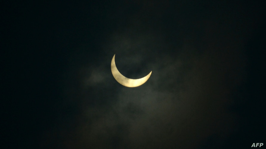 The moon partially covers the sun during an annual solar eclipse as seen from Siliguri, India, June 21, 2020.