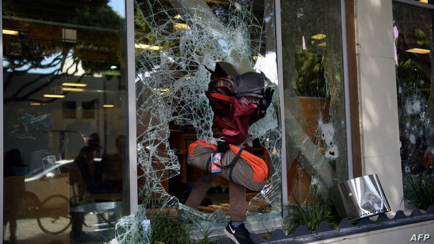 Protesters loot shops in Santa Monica, California, May 31, 2020, during a demonstration over the death of George Floyd in Minneapolis police custody.