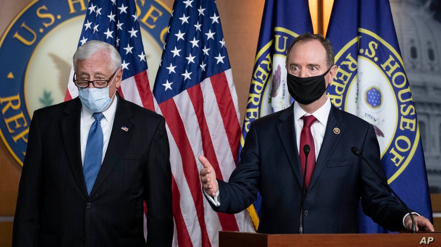 Rep. Adam Schiff, chairman of the House Intelligence Committee, right, speaks accompanied by House Majority Leader Steny Hoyer, during a news conference on Capitol Hill, after a meeting at the White House, in Washington, June 30, 2020.