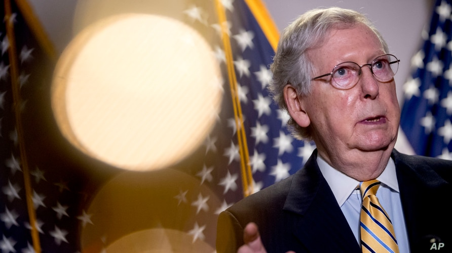 Senate Majority Leader Mitch McConnell, a Republican, speaks to reporters on Capitol Hill, in Washington, June 16, 2020. The long-time senator is expected to face a strong Democratic challenge in elections in November.