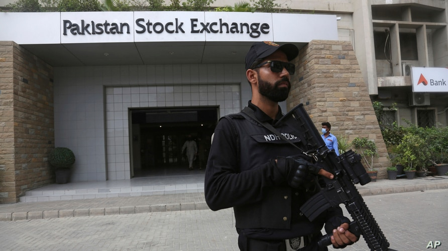 A police commando stands guard outside the Pakistan Stock Exchange after an attack in Karachi, June 29, 2020.