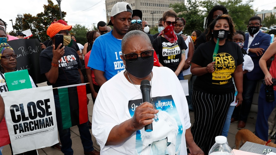 FILE - Catherine Davis, mother of Marc Davis, who was shot and killed by a Petal, Mississippi, police officer in 2017, speaks during a protest in Jackson, Mississippi, June 5, 2020.