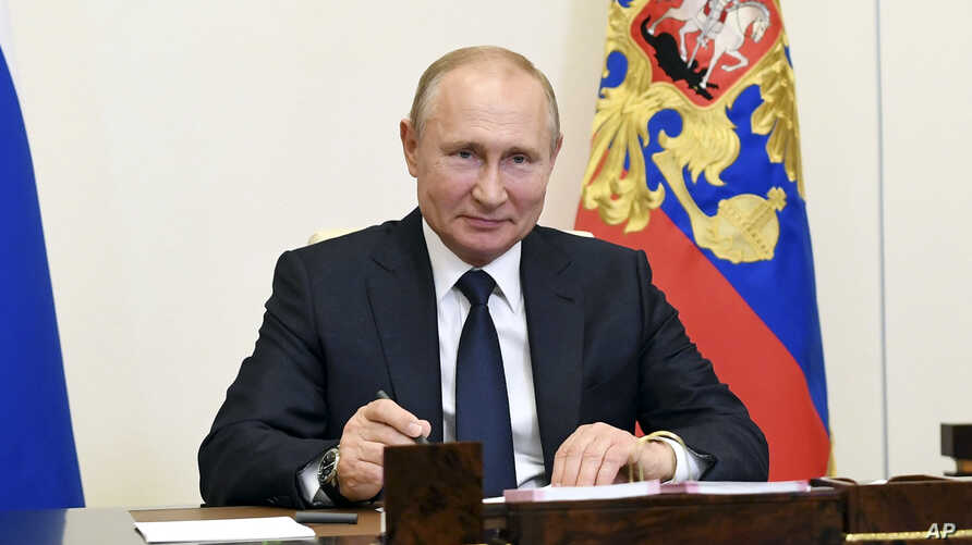 Russian President Vladimir Putin attends a meeting via teleconference at the Novo-Ogaryovo residence outside Moscow, June 1, 2020.