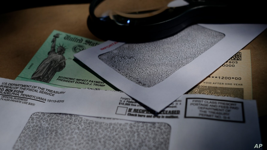 FILE - A stimulus check issued by the Internal Revenue Service to help combat the adverse economic effects of the coronavirus pandemic is seen in San Antonio, Texas, April 23, 2020.