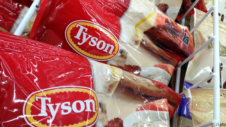 FILE - Tyson packages of frozen chicken are displayed at a supermarket in North Andover, Mass., March 6, 2017.