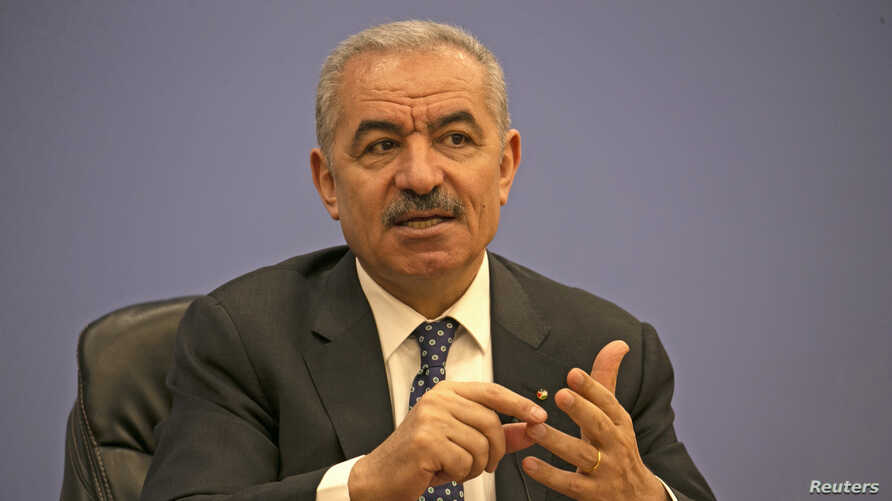 Palestinian Prime Minister Mohammad Shtayyeh addresses journalists during a meeting with members of the Foreign Press Association in Ramallah, in the Israeli-occupied West Bank, June 9, 2020.