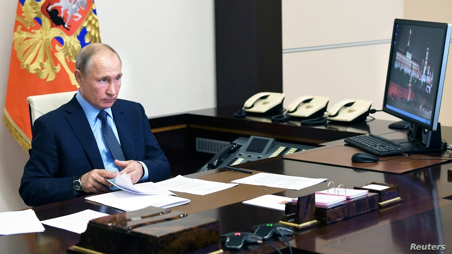 Russia's President Vladimir Putin takes part in a video conference call with health workers at the Novo-Ogaryovo state residence outside Moscow, June 20, 2020.
