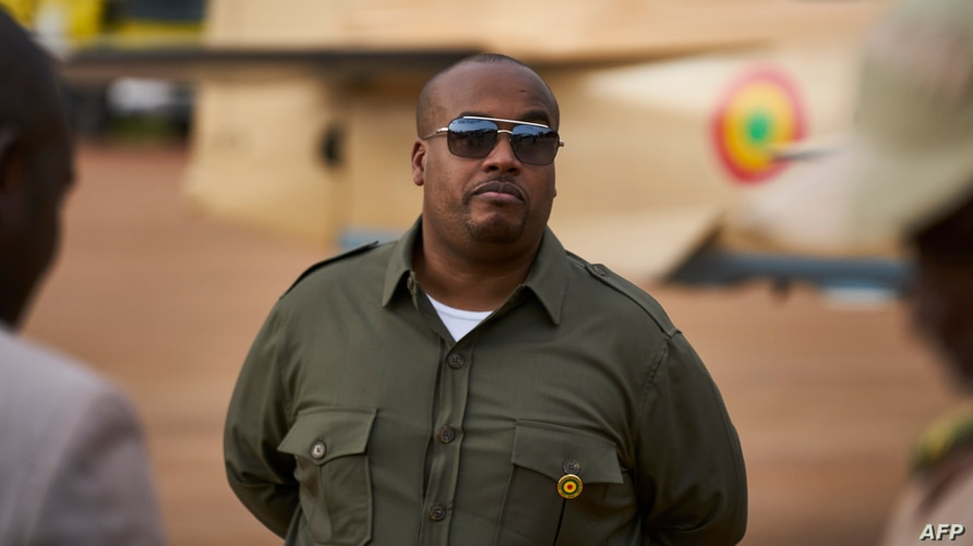 "FILE - Chairman of the Security and Defense Commission of the National Assembly Karim Keita attends the presentation of four new turboprop light attack aircrafts ""Super Tucano"" at the military air base in Bamako on July 11, 2018. Michele CATTANI / AFP"