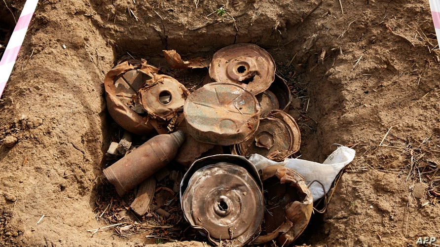 Landmines and debris from historic fighting are seen during the bomb disposal in Jebel Lemuni, 15km south of Juba, South Sudan,…