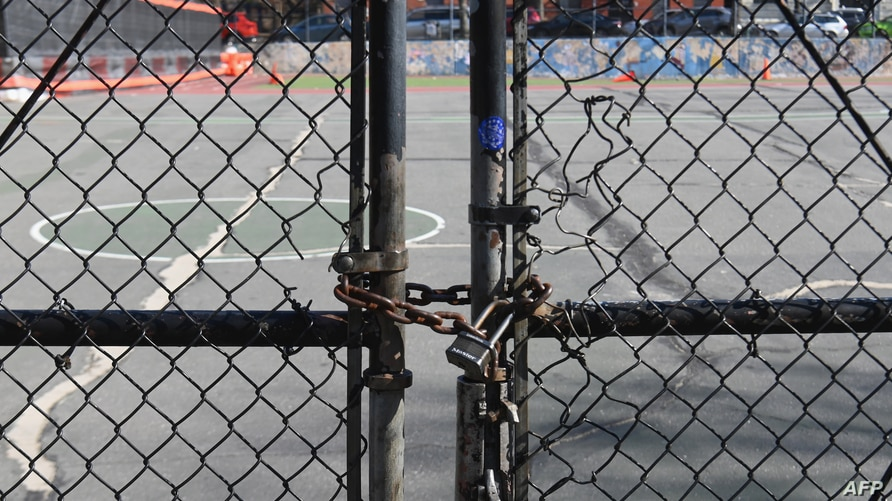 The gate at Public School 39 (PS 39) is closed with a lock on March 16, 2020 in the Brooklyn Borough of New York City. - Stocks…