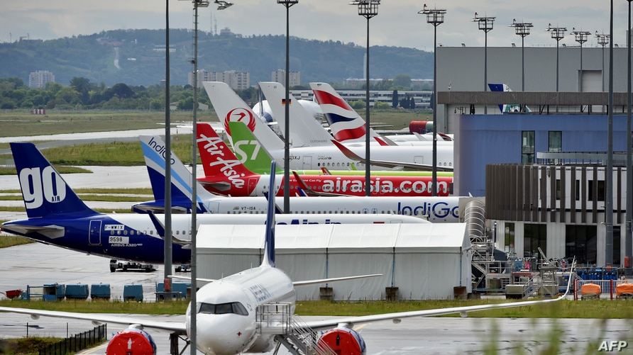 Brand new Airbus' aircrafts wait to be delivered at Airbus delivery centre at Toulouse Blagnac airport on April 30, 2020. …