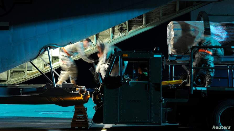 Airmen load pallets of cargo into a C-130J Super Hercules in support of Joint Task Force Odyssey Dawn (JTF OD) at Spangdahlem…