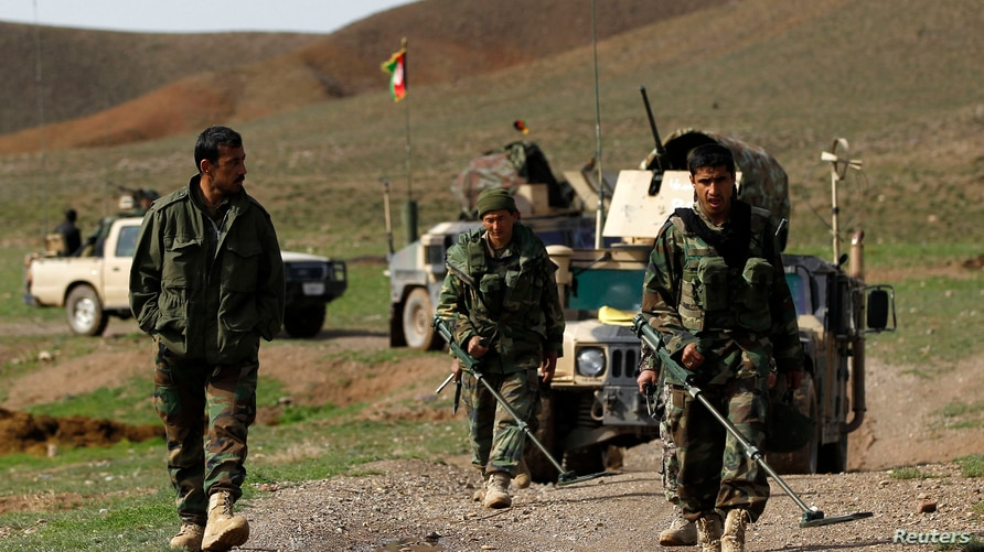 Afghan National Army soldiers (ANA) check the road before an operation at the Mir Abadi village of Adraskan district of Herat…