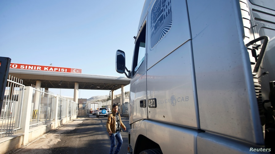 Syria-bound trucks, loaded with humanitarian supplies, arrive at Turkish Cilvegozu border gate, located opposite Syrian…