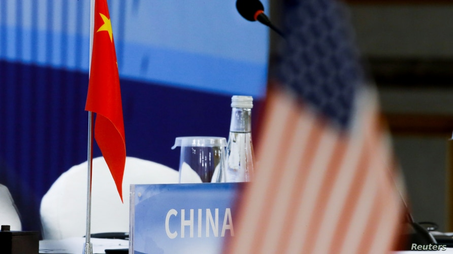 The Chinese and U.S. national flags are seen before the start of a Treaty on the Non-Proliferation of Nuclear Weapons (NPT)…