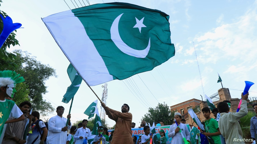 REFILE - CORRECTING GRAMMAR A man from the Pakistan's Hindu community waves a national flag during a rally expressing…