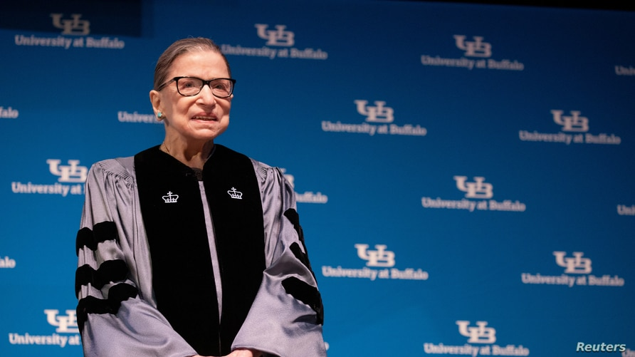U.S. Supreme Court Justice Ruth Bader Ginsburg smiles during a reception where she was presented with an honorary doctoral.