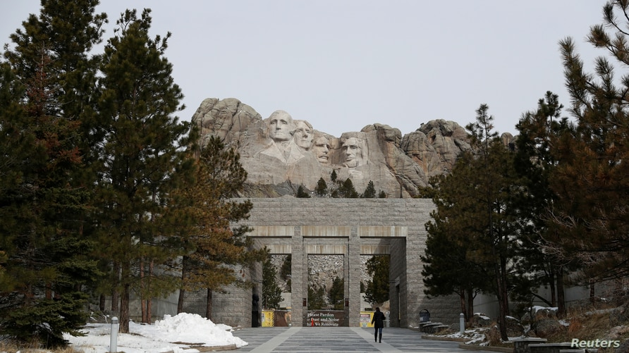 A woman walks at the Mount Rushmore National Memorial as the spread of the coronavirus disease (COVID-19) continues.