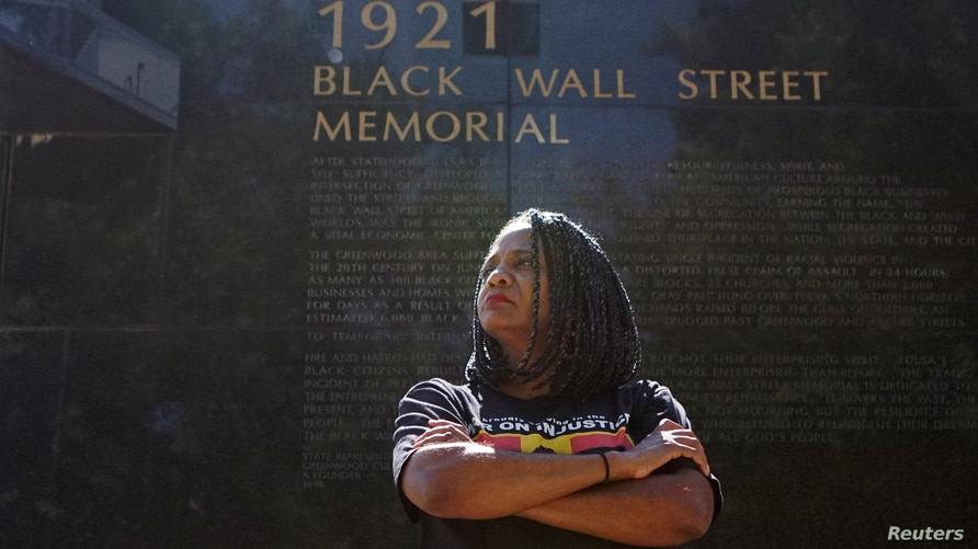 Tulsa City Councilor Vanessa Hall-Harper poses for a portrait in front of a monument to the 1921 Black Wall Street massacre in Tulsa, Oklahoma, U.S., June 18, 2020.