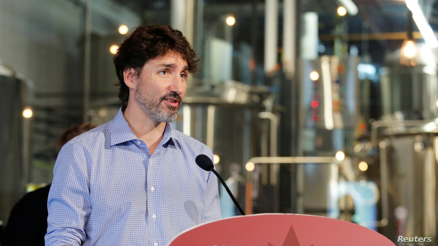 Canada's Prime Minister Justin Trudeau speaks to the media as he visits the Big Rig Brewery, which utilizes the Canada…