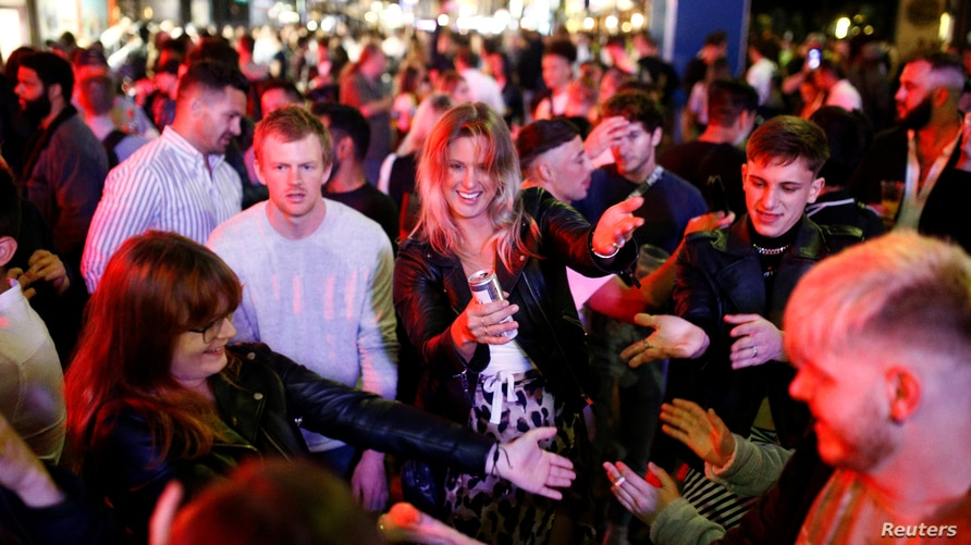 People gather in Soho, as restrictions are eased following the outbreak of the coronavirus disease (COVID-19), in London.