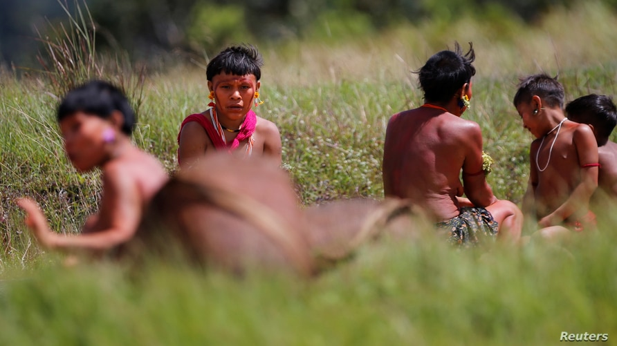 Indigenous people from Yanomami ethnic group are seen, amid the spread of the coronavirus disease (COVID-19), at the 4th…