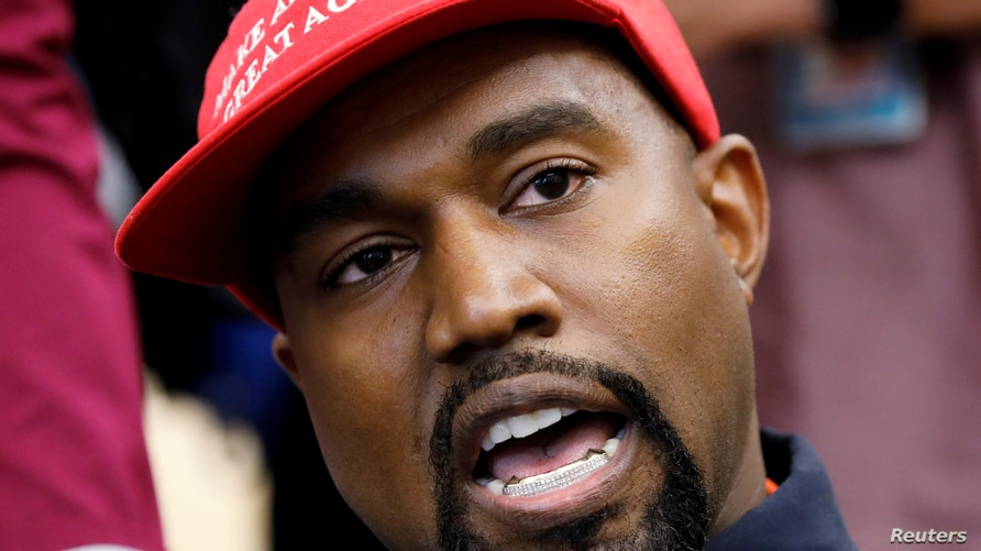 FILE - Rapper Kanye West speaks during a meeting with U.S. President Donald Trump to discuss criminal justice reform in the Oval Office of the White House in Washington, Oct., 11, 2018.